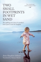 Two Small Footprints in Wet Sand